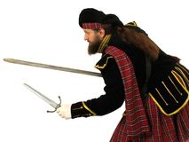 Scottish warrior with sword and dagger Stock Photos