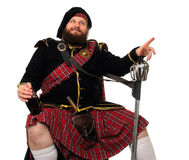 Free Scottish Warrior With Bottle Of Red Wine Royalty Free Stock Photos - 813598