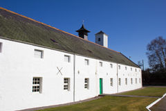 Scottish whisky distillery. Traditional typical Scottish whisky distillery building royalty free stock photography