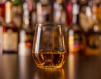 Scottish whisky in a glass with ice cubes, golden color whiskey. Exclusive drink stock photography
