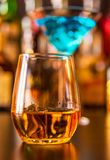 Scottish whisky in a glass with ice cubes, golden color whiskey. Exclusive drink stock images