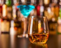 Scottish whisky in a glass with ice cubes, golden color whiskey. Exclusive drink royalty free stock images