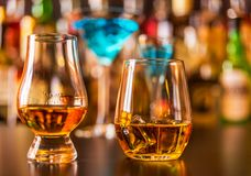 Scottish whisky in a glass with ice cubes, golden color whiskey. Exclusive drink royalty free stock photos