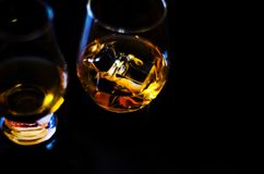 Scottish whisky in a glass with ice cubes, golden color whiskey. Exclusive drink stock image