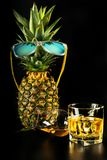 Scottish whisky in a glass with pineapple, golden color whiskey. Exclusive drink stock photos