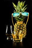 Scottish whisky in a glass with pineapple, golden color whiskey. Exclusive drink royalty free stock image