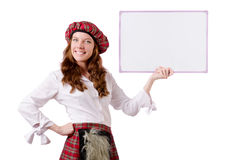 Scottish woman with board Royalty Free Stock Photography