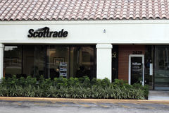 Scottrade Sign Outside in the Day. Fort Lauderdale, FL, USA - April 26, 2016: Small outdoor Scottrade sign above a covered walkway. Scottrade sign and office Stock Image