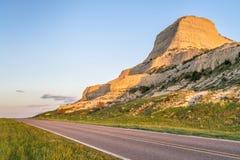 Scotts Bluff National Monument in Nebraska. Highway through Scotts Bluff National  Monument in Nebraska, spring scenery with sunset light Stock Images