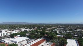 Scottsdale, Arizona, USA - rising aerial shot on a clear day with a blue sky stock video footage