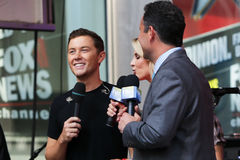 Scotty McCreery, Elisabeth Hasselbeck, Brian Kilmeade Photo libre de droits