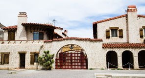 Scotty's Castle, Death Valley. Main gate of the castle in the middle of the desert Stock Photos