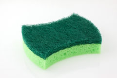 Scourer. A new, clean and colorful  green scrubber pad or scourer Stock Photography
