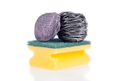 Scouring, Steel Wool Soap, Stainless Steel pad. A Scouring Pad Sponge, a Steel Wool Soap Pad and a Stainless Steel Pad isolated on a white background stock images