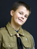 Scout with attitude. Portrait of a young scout teenage boy making a funny face Royalty Free Stock Photography