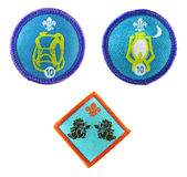Scout badges. Hikes away staged activity badge (top left). Nights away staged  activity badge (top right). Un-named ocassional activity badge Stock Photo