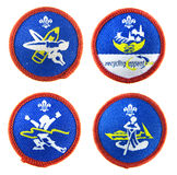 Scout badges set. Scout badges. Artist activity badge (top left). Recycling appeal activity badge (top right). Athlete activity badge (bottom left). Water sports Royalty Free Stock Photos