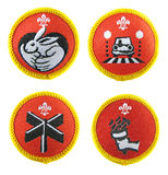 Scout badges set. Scout badges. Animal carer activity badge (top left). Road safety activity badge (top right). Explore activity badge (bottom left). Sport Stock Photo