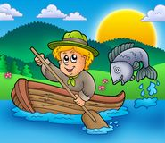 Scout boy in boat Royalty Free Stock Photos