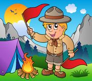 Scout boy with flags outdoor Royalty Free Stock Images