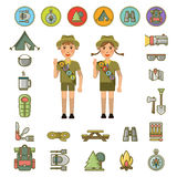 Scout boy and girl and equipment signs around Royalty Free Stock Photos