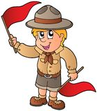 Scout boy giving flag signal Royalty Free Stock Photography