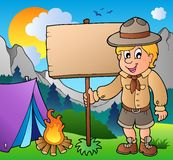 Scout boy holding board outdoor. Illustration Stock Photography