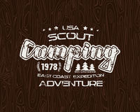 Scout camping emblem with shabby texture Stock Images