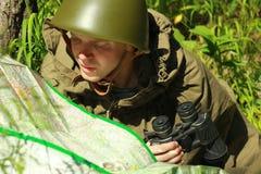 Scout dans la forêt Photos stock