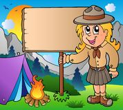 Scout girl holding board outdoor Stock Photography