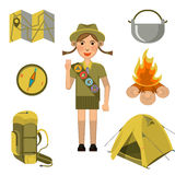 Scout girl showing honor hand sign and equipments set near Stock Photos