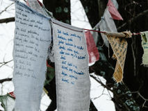Scout kid stories written on textil found in forest Stock Photography