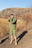 Scout leader taking a compass sighting Stock Images
