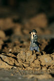 A scout. A miniature soldier is scouting on the battlefield Royalty Free Stock Photo