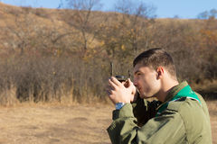 Scout or ranger taking a sighting with a compass Stock Image