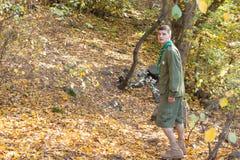 Scout or ranger walking through woodland Royalty Free Stock Image