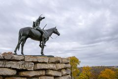 The Scout statue,Kansas city Missouri. With the Kansas city skyline in fall colors stock photography