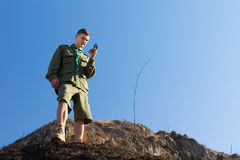 Scout using a magnetic compass to navigate Stock Photo