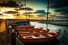 Scouting the sunset. Sea scout boats at Jaffa port just before the sun is down Royalty Free Stock Images