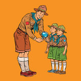 Scoutmaster shows little insect to young scouts. Pop art retro vector illustration. Nature and science Royalty Free Stock Photos