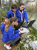 Scouts with laptop. Map and compass in nature stock photography