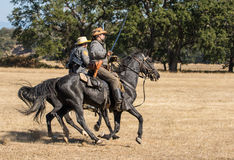 Scouts on the Move. Two Confederate Cavalry Scouts ride towards the front lines during American Civil War reenactment at Hawes Farm in Anderson, California royalty free stock photography