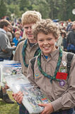 Scouts selling programs at Braemar. Scouts in uniform with Jubilee badges selling programs at the Braemar Royal Gathering on 1st September 2012 Royalty Free Stock Photo
