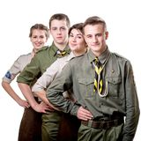 Scouts in studio. Four young scouts members in uniform on white background royalty free stock images