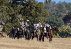 Scouts At War. Rebel cavalry scouts ride up to enemy positions during a Reenactment at Hawes Farm in Anderson, California on October 4, 2015 stock image