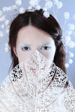 Scowl. Beautiful frozen woman on blue background Royalty Free Stock Image