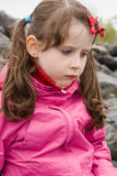 Scowled girl Stock Images