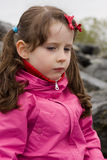 Scowled girl Stock Photo