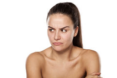 Scowling woman without makeup Royalty Free Stock Photography
