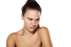 Scowling woman without makeup Royalty Free Stock Image